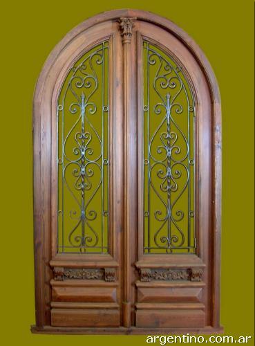 Puerta doble hoja de entrada medio punto en madera en for Puertas doble hoja interior madera